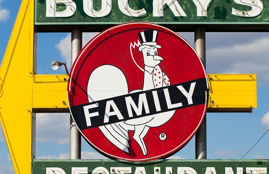 Family sign with rooster on it