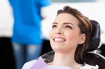 young woman smiling in dental chair