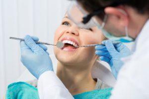 Smiling woman having a dental exam