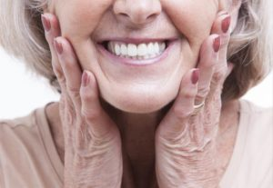person with dentures smiling