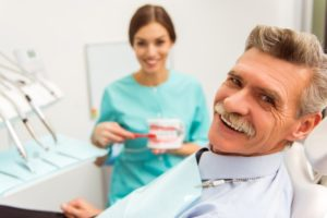 man at a consultation for dentures in Columbia