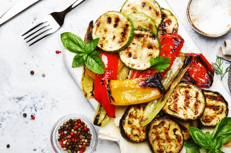 a table complete with summer foods in Columbia that consist of grilled vegetables